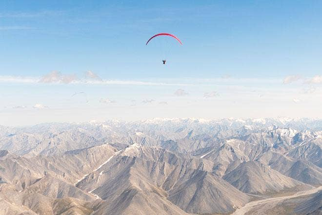Paraglider above the mountains